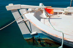 Fresh fishes with vegetables and traditional boat in Aegean Royalty Free Stock Photo
