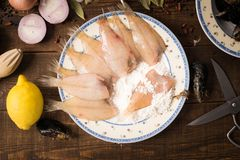 Fresh fishes on a wooden background Royalty Free Stock Photos