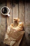 Fresh flaky croissant with espresso coffee Stock Photos