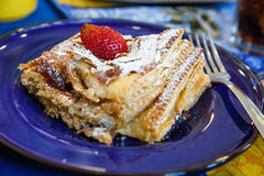 Fresh Flaky Pastry on Blue Plate with Whole Strawberry Stock Image