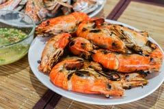 Fresh flaming shrimp with chili sauce Stock Photos
