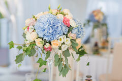 Fresh floral composition on the holiday table. Beautifully organized event - served banquet tables ready for guests Stock Photography