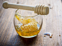 Fresh floral honey with honeycomb in a small glass Stock Images