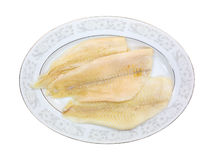 Fresh flounder fillets on oval platter Royalty Free Stock Photo