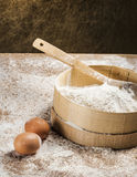 Fresh flour with eggs Stock Image