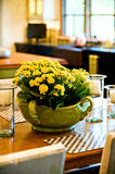 Fresh flower arrangement on the dining room table royalty free stock photo