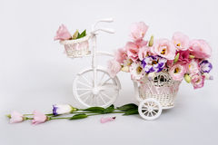 Fresh flower bouquet in a decorative white carriage Stock Image