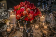 Fresh flower and candle centerpiece at Christmas. Beautiful fresh flower arrangement and multiple candles centerpiece at a Christmas party in Wisconsin Royalty Free Stock Images