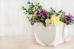 Fresh flowers in box on a wooden background. Copyspace Royalty Free Stock Photography