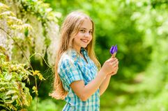 Fresh flowers. Collecting flowers in field. Summer is here. Kid hold flowers bouquet. Girl cute adorable teen dressed. Country rustic style checkered shirt royalty free stock image