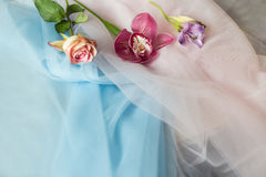 Fresh flowers on the fabric blue pink Stock Photos
