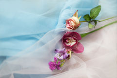 Fresh flowers on the fabric blue pink Stock Photography