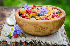Fresh flowers and fruits with cornflakes Royalty Free Stock Photography