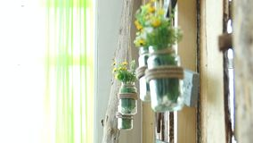 Fresh flowers in a glass jar stock video footage