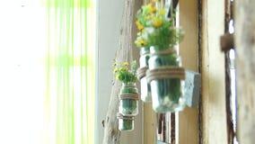 Fresh flowers in a glass jar. In photo studio stock video footage