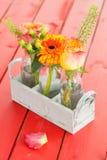 Fresh flowers in little bottles Stock Photo