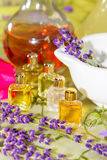 Fresh flowers, pestle, flask and essential oil Stock Photo