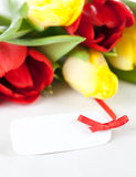 Fresh flowers and white tag Stock Photo