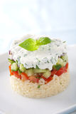 Fresh food. Small tower of risoni, tomatoes, cucumber and ricotta with herbs Royalty Free Stock Photography