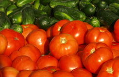 Fresh food. Fresh tomatoes and cucumbers for sale at the market Stock Photo