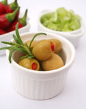 Fresh food. Some fresh green olives, chili and onions Stock Images