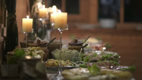 Table full of meat at the wedding. Fresh food from catering dinner table. food on plates from catering table full of different meat types stock footage