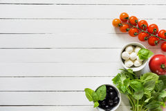 Fresh food cooking ingredients on white wooden table Royalty Free Stock Images