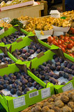 Fresh food at a french market. Fresh figs, nuts, tomatoes and mushrooms at a Parisian market Royalty Free Stock Images