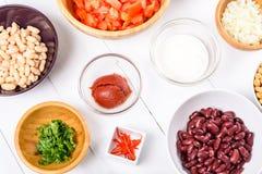 Fresh Food Ingredients On White Kitchen Table Stock Photo