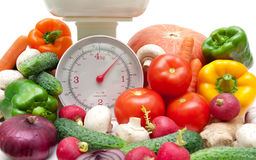 Fresh food and kitchen scale closeup Stock Photos