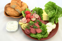 Fresh food plate with rollbread. Sandwich ingredients put together on the plate next to bread and tzaziki Royalty Free Stock Image