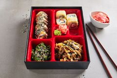Fresh Food Portion in Japanese Bento Box with Sushi Rolls stock images
