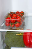 Fresh food on the shelves in the fridge Stock Photo