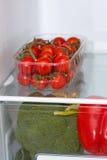 Fresh food on the shelves in the fridge Stock Photo