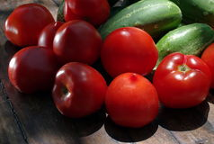Vegetables. Fresh food on the table: tomatoes and cucumbers Stock Image