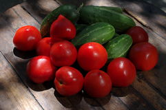 Vegetables. Fresh food on the table: tomatoes and cucumbers Stock Photography