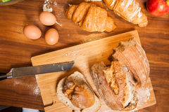 Fresh food on wooden kitchen table with Royalty Free Stock Photography