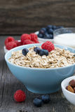 Fresh foods for a healthy breakfast on the wooden background Stock Image