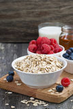 Fresh foods for a healthy breakfast on the wooden background Stock Images