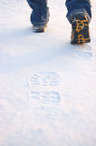 Fresh footprints from man boots on snow Royalty Free Stock Image