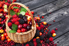 Fresh forest berries in basket on wooden background. Copy space. Fresh forest berries in basket on rustic wooden background. Copy space Royalty Free Stock Image