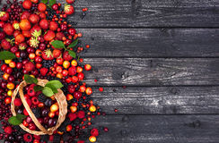 Fresh forest berries in basket on wooden background. Copy space Stock Photo