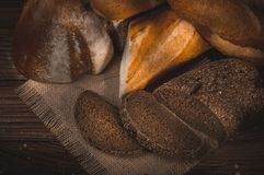 Fresh fragrant bread on the table. Food concept Stock Images