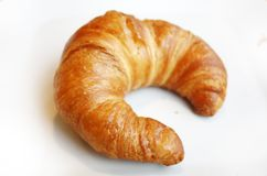 Fresh fragrant butter croissant. On the white plate Stock Image