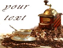 Fresh fragrant coffee and coffee grinder Royalty Free Stock Images