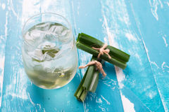 Fresh Fragrant Pandan  Ice Tea and leaves on wood background Stock Photo
