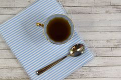 Fresh fragrant tea in blue Cup. Fresh fragrant tea in blue Cup on wooden background royalty free stock image