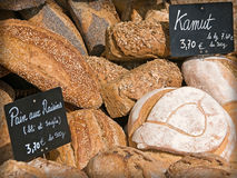 Fresh French Bread On Market. This close-up shot of loaves of French bread was taken in natural sunlight at a market in France Stock Photography