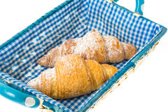 Fresh French croissants in basket Stock Image