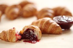 Fresh french croissants with berry jam Stock Images